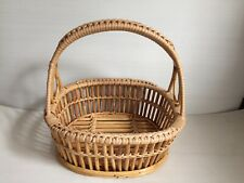 Vintage handwoven rattan handle basket