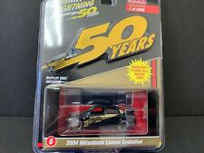 Johnny Lightning Mitsubishi Lancer EVO 2004 Black and Gold JLCP7197 1/64
