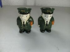 VINTAGE PAIR OF HARRODS DOORMEN EGG CUPS