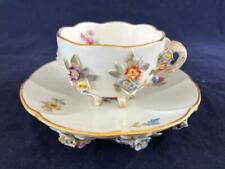 FINE ANTIQUE MEISSEN PORCELAIN HAND PAINTED FLOWER ENCRUSTED CUP AND SAUCER.
