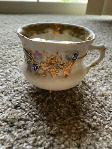 Beautiful Vintage mustache Cup with raised Flowers and gold etchings