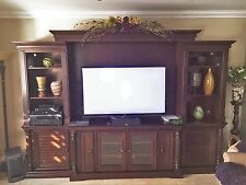 "Dark brown wall unit - holds up to a 65"" TV"