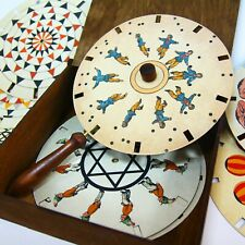 Phenakistiscope stroboscope. Optical antique toy with set of 12 animation discs