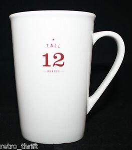 Starbucks Coffee 2010 Tall 12 Ounces White Ivory Coffee Tea Mug Cup Brown Star