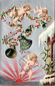 1907 Cherubs Bells Rising Sun Antique Christmas Embossed Germany Postcard IE