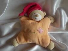 Doudou ours orange, bonnet rouge, papillon, grelot, semi-plat, Nattou
