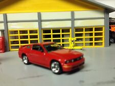 1/64 2005 Ford Mustang GT in Red/Blk Int V8 6 Speed with Factory Alloy Wheels