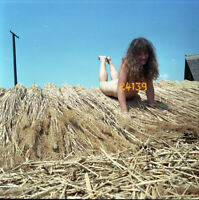 nude girl smiling on rows, vintage fine art negative, 1970's