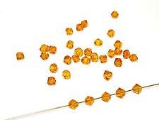 Swarovski® Perlen, 4mm Bicone, topaz, 100 Stück #SW09-100