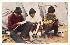 ESKIMO BOYS CARVING IVORY ALASKA POSTCARD (c. 1920)