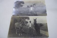 TWO VINTAGE POSTCARD MAN HOLDING ON TO TWO HORSES