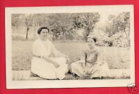 RPPC WOMAN & GIRL SITTING ON SIDEWALK NECKLACES WITH LOCKETS REAL PHOTO POSTCARD