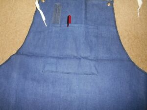 """SHOP APRON BRAND NEW IN PACKAGE 27"""" WIDE X 35"""" LONG. WITH THREE DRAW STRINGS."""