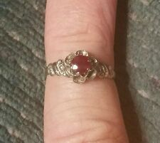 .33ct. natural ruby set in a solid 14kt. white gold floral ring setting