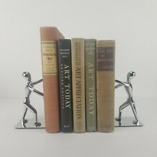 Modern Bookends Doorstop Man Figure Holding Pushing Books Chrome MCM Style