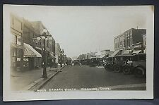 "1930 real photo postcard ...MANNING, IOWA....""Main Street North""...busy downtown"