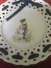 Romantic Edwardian Porcelan Ribbon Plate Depicting An Embracing Couple