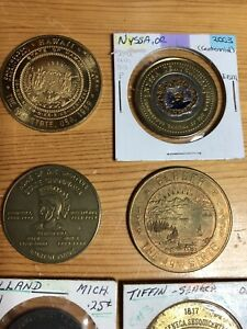 Lot Of 8 USA Trade Tokens Medals 1951 - 2003 Alaska Nyssa Hawaii Attica Holland