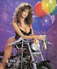RACQUEL DARRIAN - IN A ONE PIECE STRADDLING A MOTORCYCLE !!!