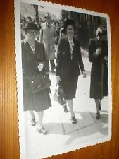 Old photograph people walking c1955
