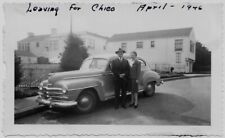 OLD PHOTO CAR WOMAN AND MAN SIDE OF ROAD HOUSES 1940S