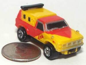 Small Micro Machine Plastic Toyota Hi-Lux Pickup truck / Red & Yellow marked 4X4