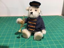 STEIFF DOG BANDSMAN WITH TROMBONE FROM CIRCUS BAND   Limited edition 1989. 19 cm