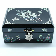 Black jewelry box inlaid with mother of pearl and tortoise shaped metal latch