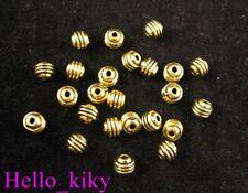 200Pcs Antiqued gold plt triple-lined barrel spacers A109