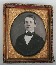 DAGUERREOTYPE MAN WITH SLICKED DOWN HAIR. TINTED, 6TH PLATE, HALF CASE.
