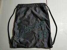 Nike Jordan 23 signature style with mesh black and silver. Draw string gym bag.