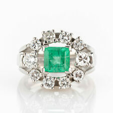 Ladies´ ring (18k gold) with an emerald and diamonds