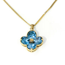 Vintage blue Topaz  flower shaped pendant on a yellow gold chain, Beautiful.