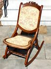 Antique Victorian folding rocking chair with cushioned floral tapestry seat