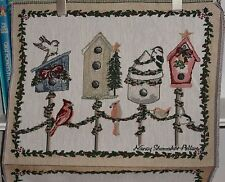 tapestry  with bird houses on it.  great for a pillow