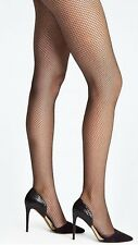 NWT bebe Fishnet Tights SIZE M/L Fabulous fishnet tights that heat up looks from