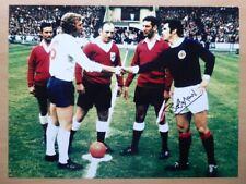 """Bobby Moncur Signed 16x12"""" Scotland v England Bobby Moore Photograph (950)"""