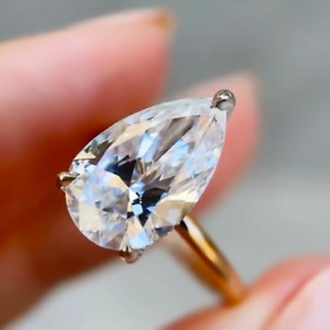 4.29 TCW Pear Cut D VVS1 Moissanite Engagement Ring In 14k Yellow Gold