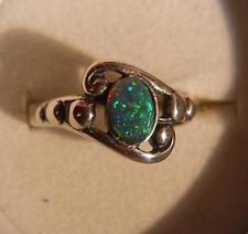 Sterling ring beautiful yellow green blue 0.50 ct natural Australian Black Opal
