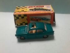 LONE STAR FLYERS number 28 PEUGEOT 404 in mid  Green  in exc cond  BOX creased
