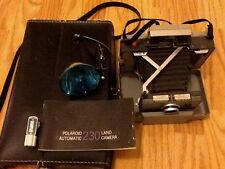 L035  Vintage Polaroid 230 Camera with Self-Timer, Flash, Booklet  and Case