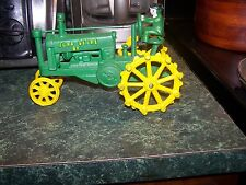 Vintage Metal John Deere  Tractor  with a man driving it very unique