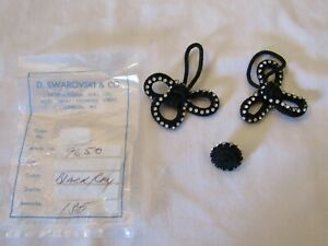 1 SET OF BLACK CORD  FROG FASTENERS WITH SWAROVSKI CRYSTALS.
