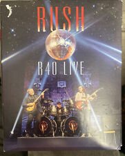 A CD Music Rush R40 Live 3 Disc Album with 1 DVD Total 4 discs