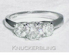 18 Carat White Gold Round Three-Stone Fine Diamond Rings