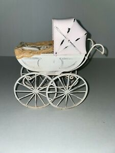 """7 1/2"""" tall Metal doll buggy"""