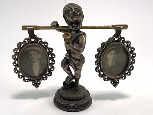 Vintage Decorative Ornate Metal Photo Holder Boy Carrying Two Frames
