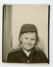 Smiling young boy in hat posing in photobooth Vintage photo booth