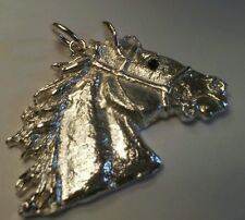 A horse in sterling silver with blue sapphire eye