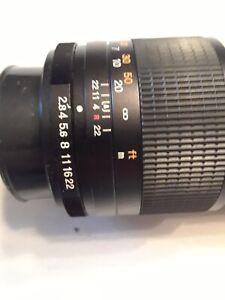 Minolta MC 135mm 1:28 RokkorCeltic telephoto lens w/ hard leather case/excellent